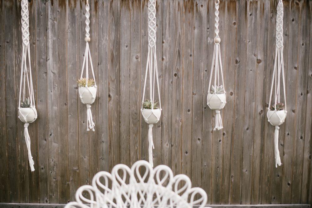 White Macreme Wall Hangings at Baby Shower | White Boho Baby Shower