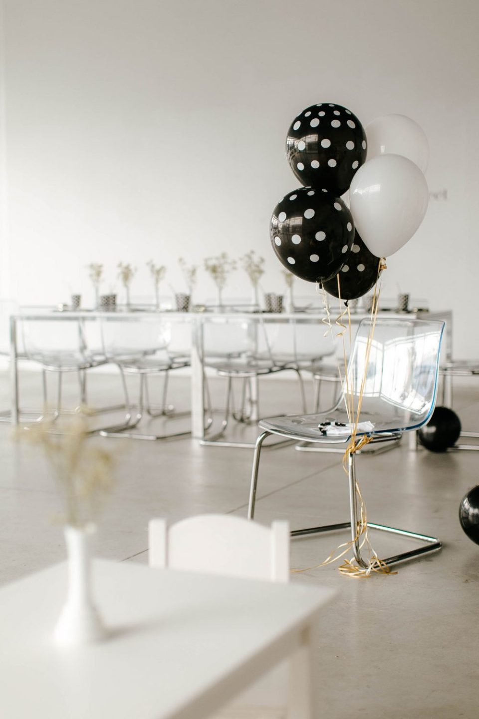 Black White and Polka dots gender neutral birthday party set up