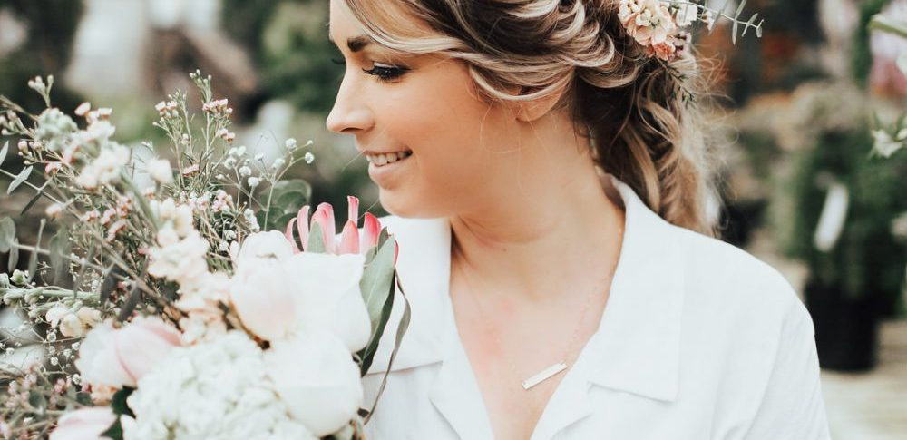 Styled Photoshoot in a Greenhouse | Floral and eucalyptus bouquet, Fishtail Braided Hair in Ponytail, and a Tulle Skirt