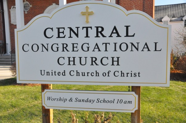 "This sign is 60"" wide x 32"" high x 1""thick PVC, black letters on white with 23kt gold border and cross"