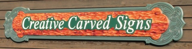 "This sign is 94"" wide x 12"" high, with a 3/4"" thick textured carved Red Cedar background installed over a 3/4"" green composite."