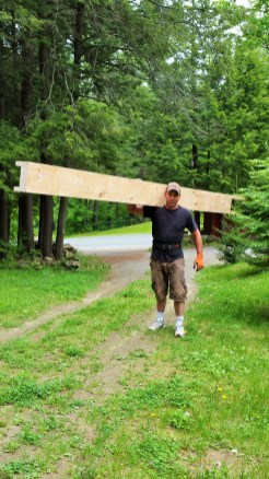 bringing-timber-beam-into-the-house (5)