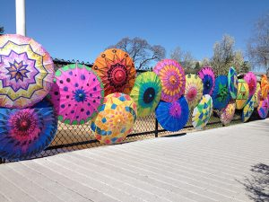 Installation of hand-painted parasols in Beverly, MA