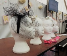 fascinator with birdcage veil on mannequin head