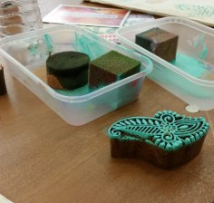wooden block printing with teal paint