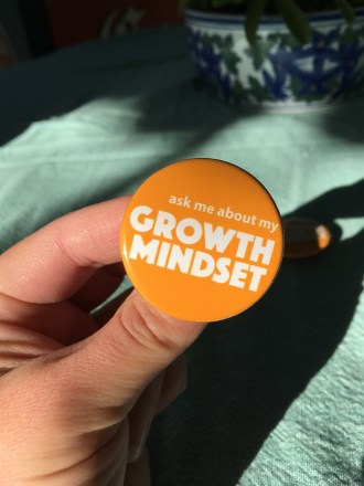 """A wearable conversation starter """"ask me about my Growth Mindset"""""""