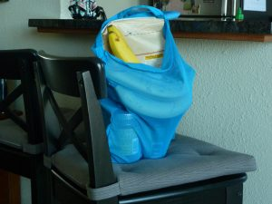 upcycled shopping bag full of groceries on a chair
