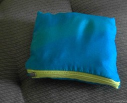 zippered storage pouch for upcycled shopping bag made from pocket of old jacket