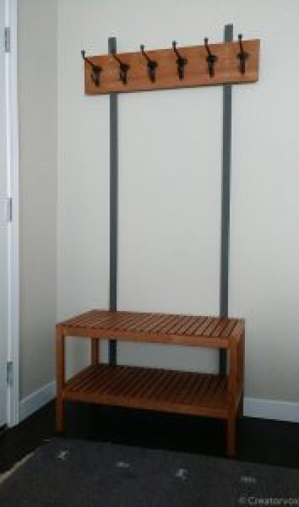 Entryway organizer with bench, shoe storage, and six coat and hat hooks