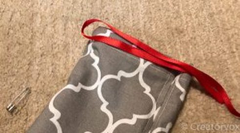 drawstring bag with red ribbon to be threaded through the top