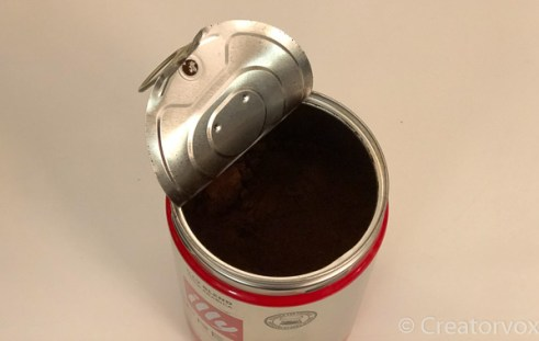 coffee can with the factory lid half-off