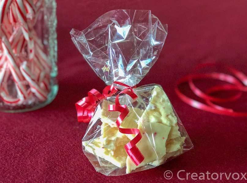 bag of peppermint bark next to a jar of candy canes