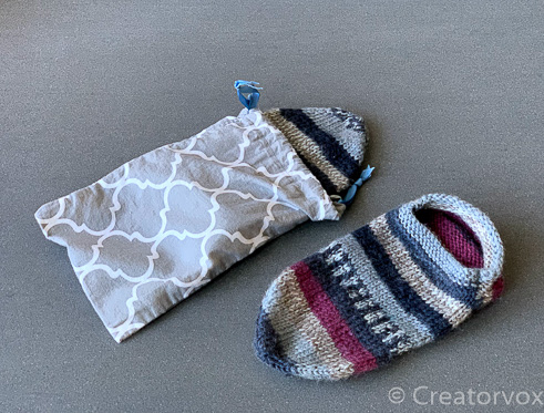 Handmade travel slippers with a cotton drawstring bag