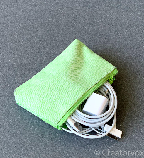tiny zipper pouch with electronics for in-flight use