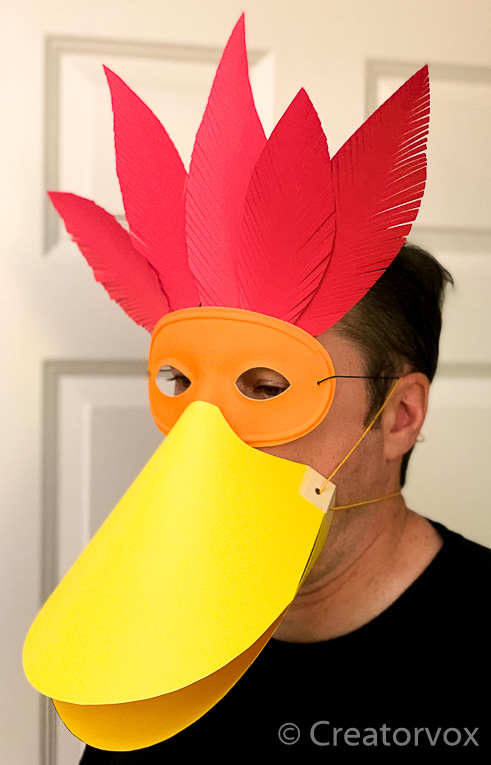 abstract paper bird mask with opening mouth