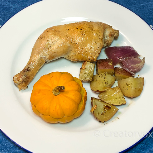 plate with chicken and mini pumpkin