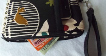 Wristlet with phone, money and credit cards