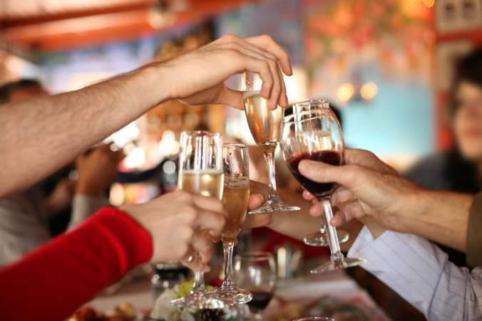 People Toasting with Champagne and Wine at Party