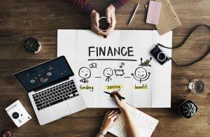 Finance Flowchart with Laptop on Desk