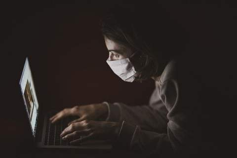 Woman with Mask on Video Chat