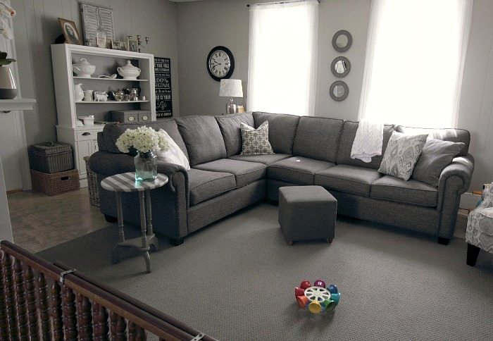 grey rug living room beautiful curtains for small how to make a cheapo area feel like million bucks the creek even if you have really cheap basic can it