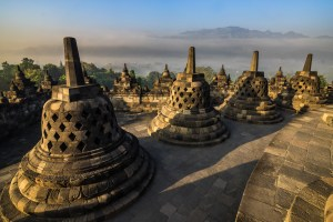 Classic view of Borobrodur bells in morning mist