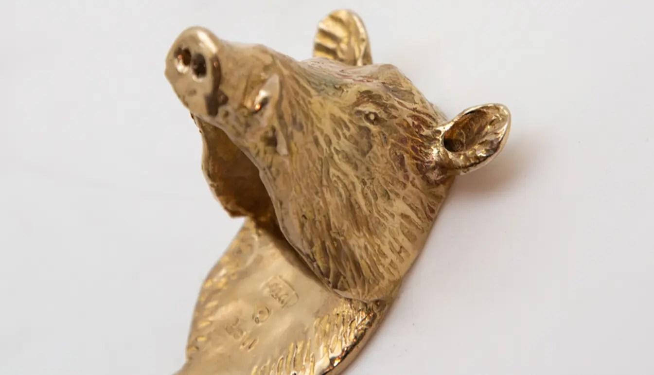 boars-head-opener-brass