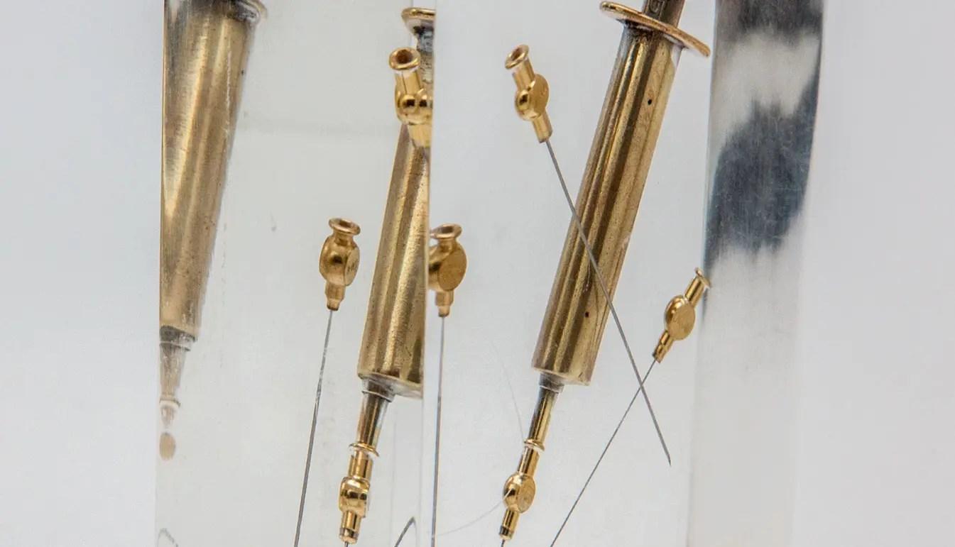 Gold-syringe-in-lucite