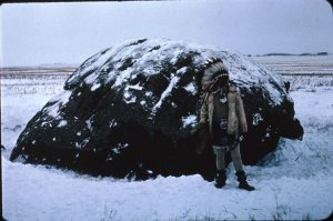 This is my late father Wilfred Tootoosis, Cree Assiniboine (Nakota) standing in front of Mistassini. This big rock was blown up by the Saskatchewan Government in the 1960s despite a heroic effort by First Nations (including my late father and family friend Ms Buffy St Marie) and non-First Nations who fundraised so that the rock could be moved to a safe place. However, the Government proceeded to blow it up so that it wouldn't be in the way as the Gardiner Dam was being built. My Dad took several dancers from Poundmaker and Little Pine to do one last ceremonial at and for Mistassini prior to it being blown up.