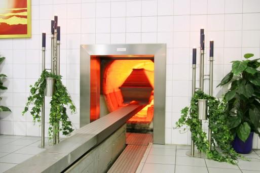 Casket entering cremation chamber