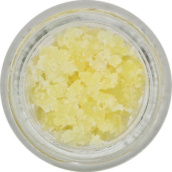 Micro sized THC-A diamonds that are pale yellow in color from their soaked up terpenes, sitting in a jar.