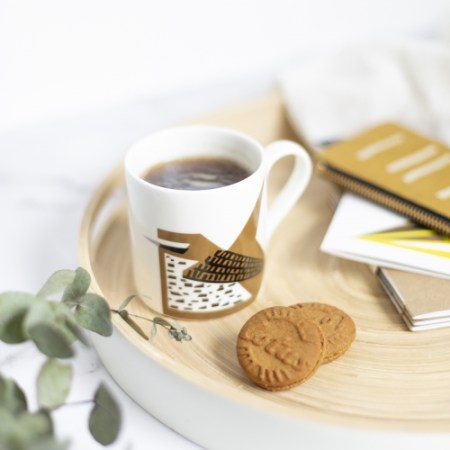 Wren mug on a tray with biscuits