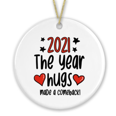 """Circle shaped ceramic bauble with the phrase """"2021 The Year Hugs Made a Comeback"""""""