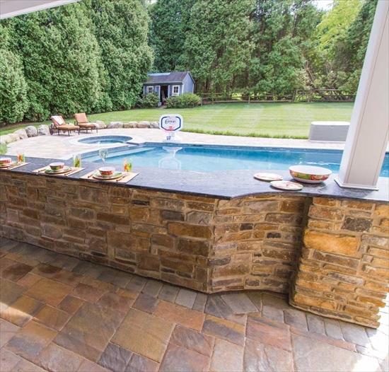Beautiful Stone Breakfast Bar built off of the pool