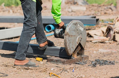 Worker using cutting tools while wearing open-toed sandals. This could happen if you didn't pick the right contractor.
