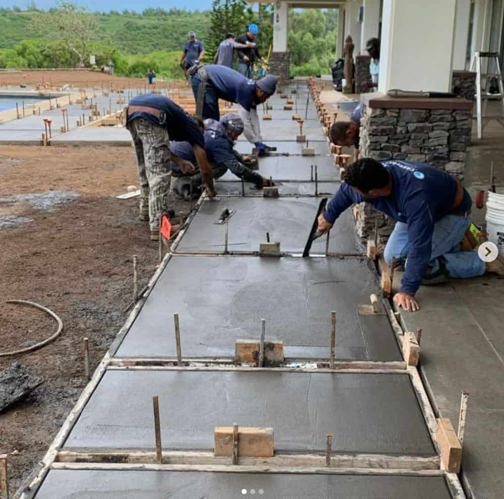 Crescent Homes Maui employees installing a new concrete walkway.