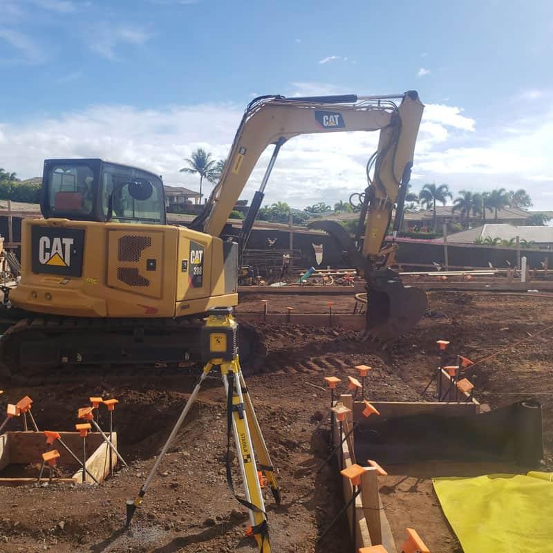 CAT Excavator preparing the site a new Maui home.