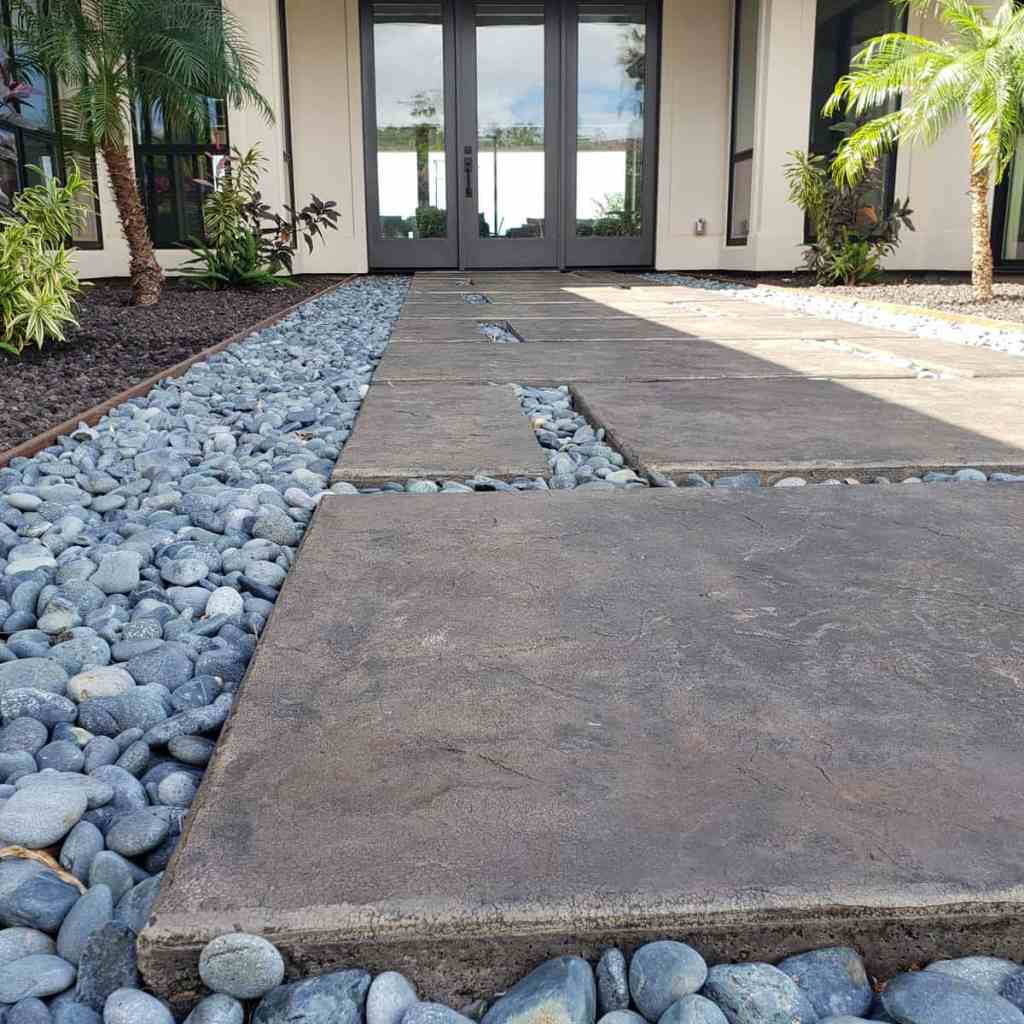 Another look at the stamped concrete pads surrounded by decorative stones.