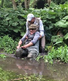 pulling fisherman out of the river