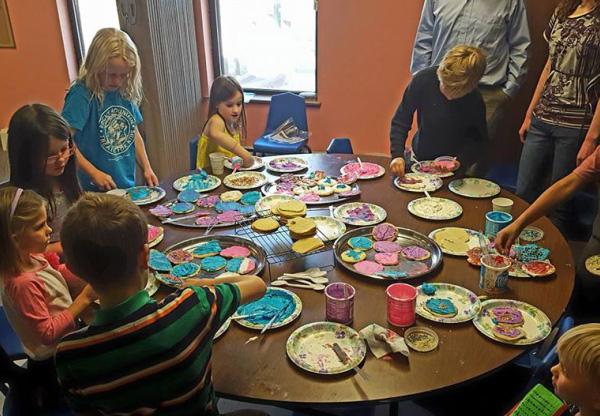 Photo of kids baking cookies in Children's Worship.