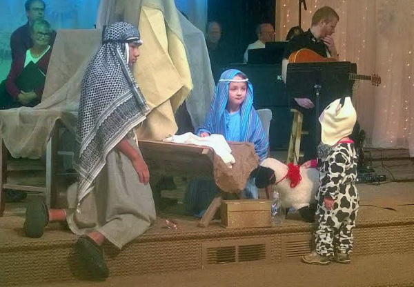 Photo of Christmas Eve service with kids acting out the nativity scene.