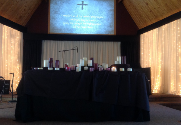 Photo of Ash Wednesday table of candles in the sanctuary.