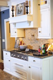 White Inset Cabinets with Custom Hood