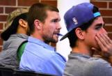 Nate Klein and others listen to Rue Patel.