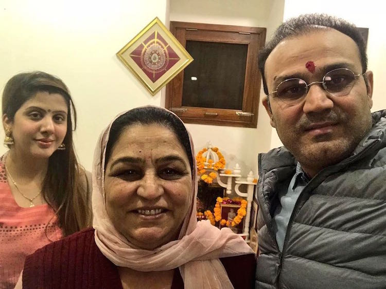 Virender Sehwag with his mother and wife Aarti