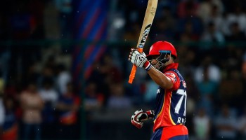 Delhi Daredevils' Rishabh Pant raises his bat scoring fifty runs
