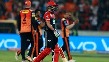 Royal Challengers Bangalore player Virat Kohli walks towards pavilion after dismissed by Sunrisers Hyderabad bowler Shakib Al Hasan during VIVO IPL cricket T20 match in Hyderabad