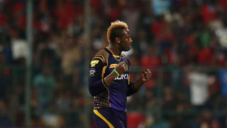Kolkata Knight Riders' bowler Andre Russell celebrates the dismissal of Royal Challengers Bangalore batsman Mandeep Singh