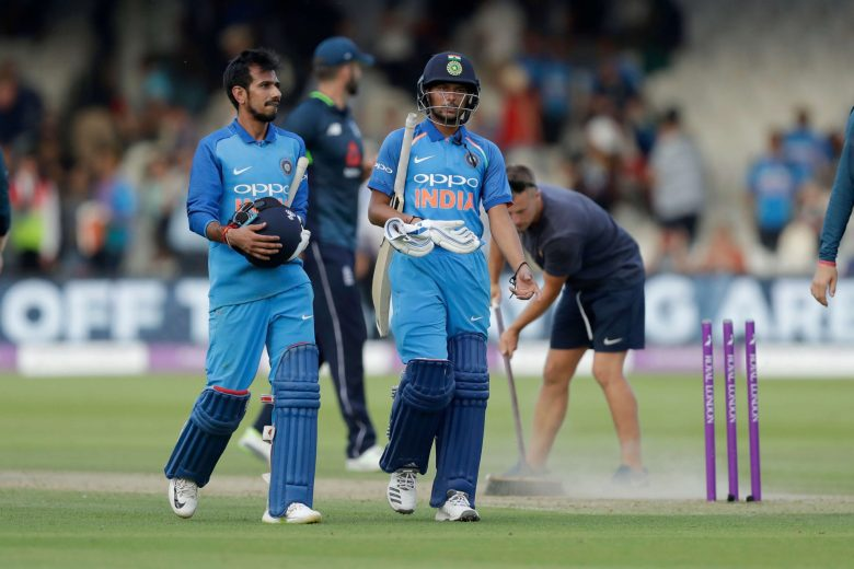 India's Yuzvendra Chahal, left, and India's Kuldeep Yadav walk off the field of play at the end of the one day cricket match