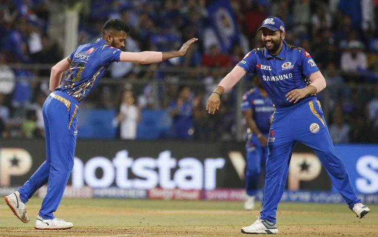 Mumbai Indians Hardik Pandya, left, with Rohit Sharma celebrates the dismissal of Royal Challengers Bangalore Parthiv Patel